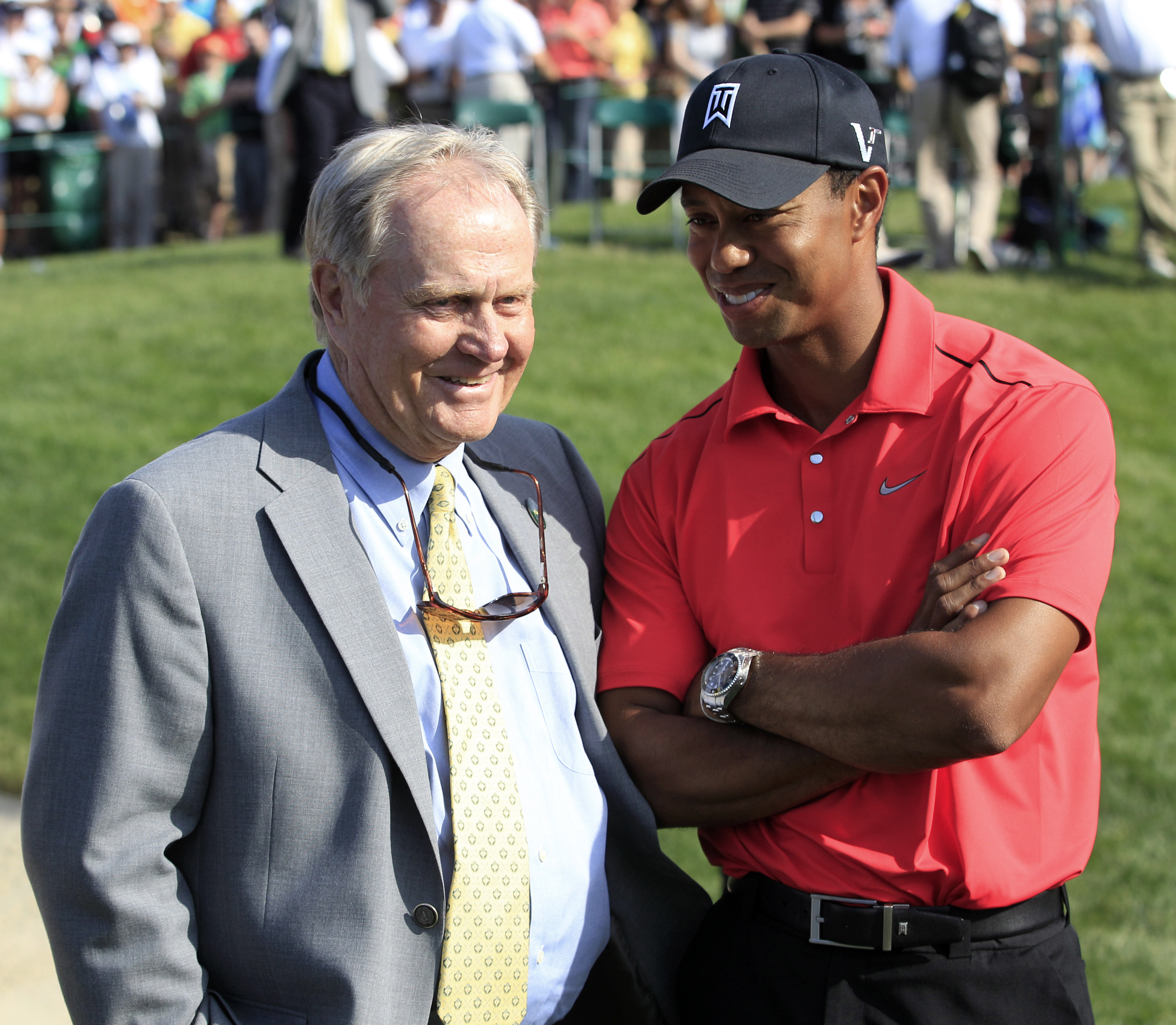 Jack Nicklaus talks with Tiger Woods after Woods won the Memorial golf tournament in 2012.