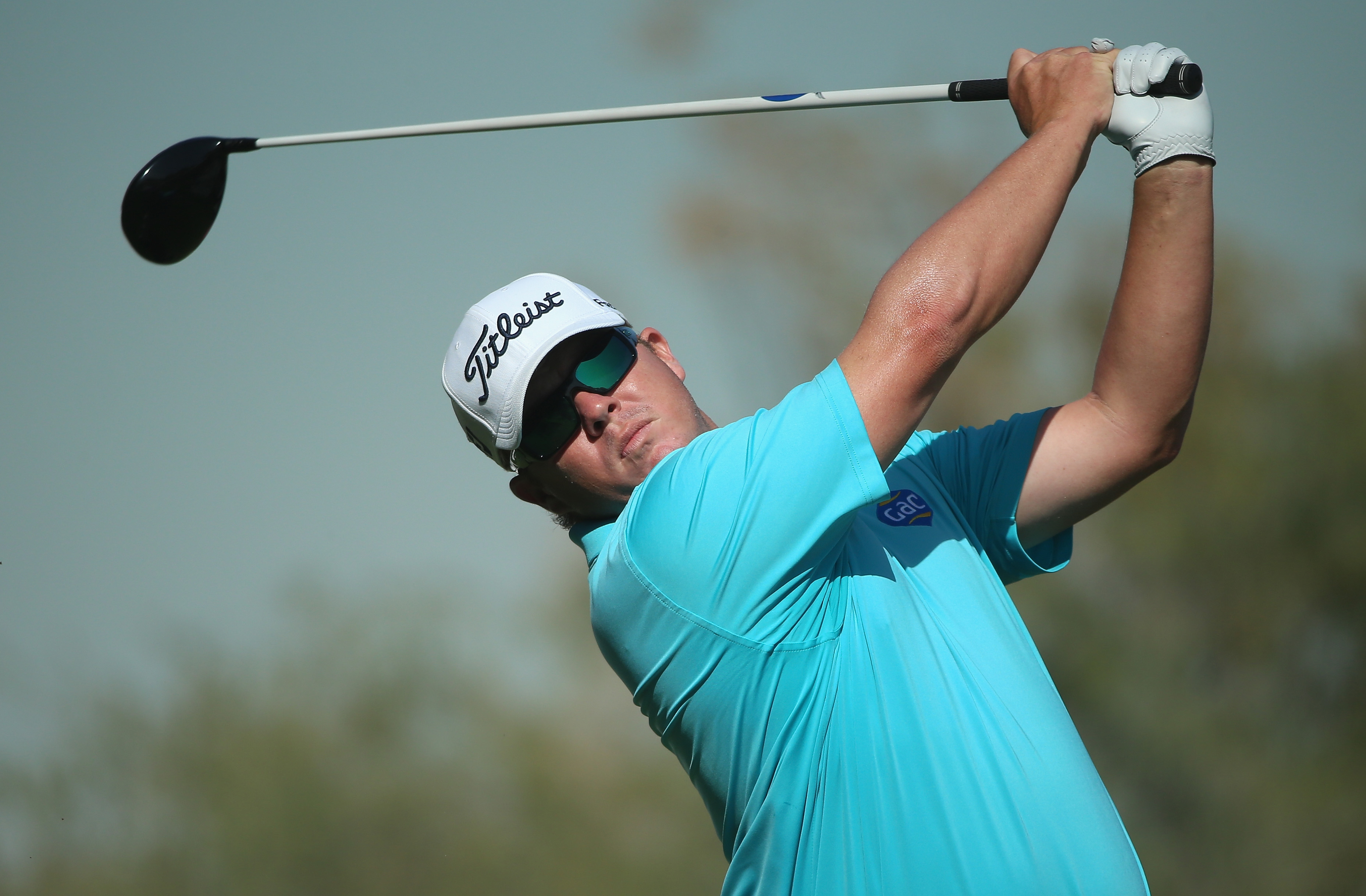 George Coetzee of South Africa watches his tee shot during the final round of the Commercial Bank Qatar Masters at Doha Golf Club on Jan. 24, 2015, in Doha, Qatar. He'll defend his Joburg Open title this week.