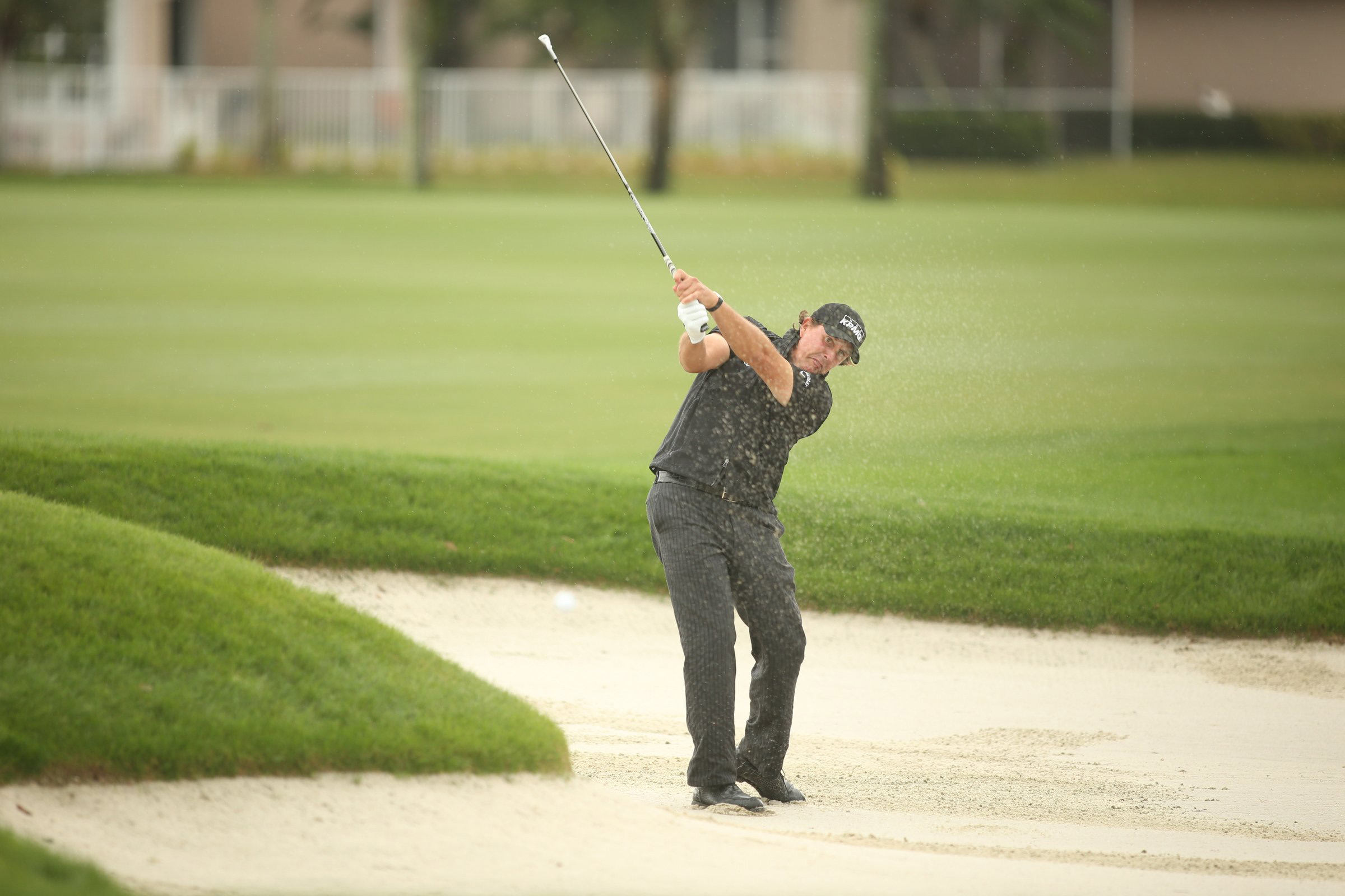 Phil Mickelson from a fairway bunker at PGA National.