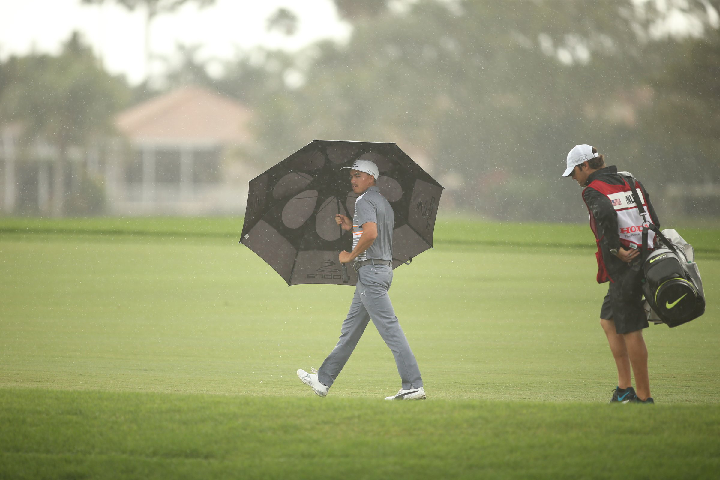 Rickie Fowler tries to stay dry during Saturday's rain-shortened third round of the Honda Classic in Palm Beach Gardens, Fla.