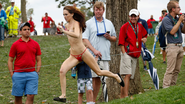 A streaker runs on the 18th hole during the Day Four Singles Matches at the Muirfield Village Golf Club on October 6, 2013 in Dublin, Ohio.