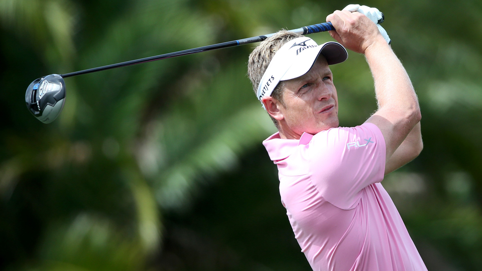 Luke Donald of England plays his tee shot on the eighth hole during the continuation of the third round of The Honda Classic March 1 in Palm Beach Gardens, Fla.