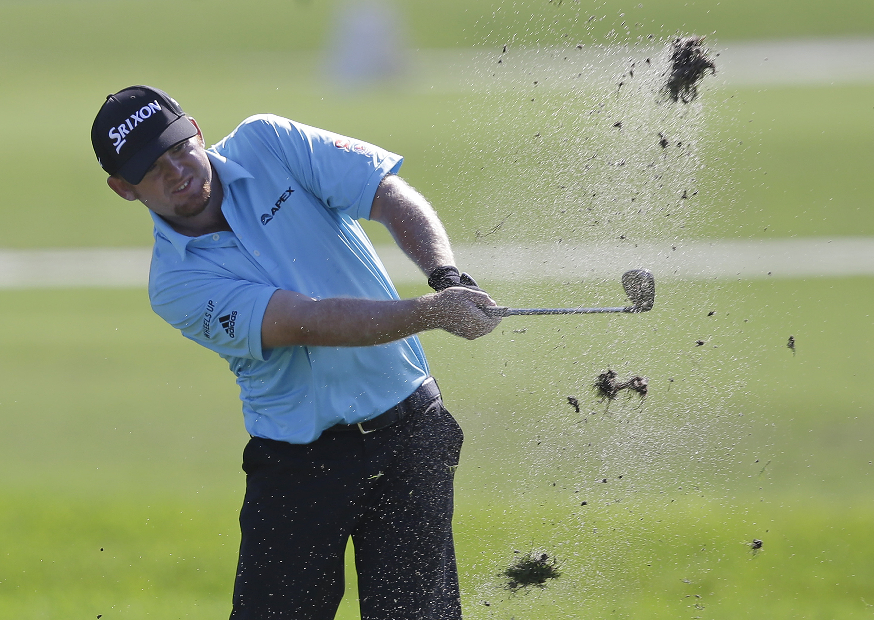 J.B. Holmes hits on the second fairway during the first round of the Cadillac Championship.