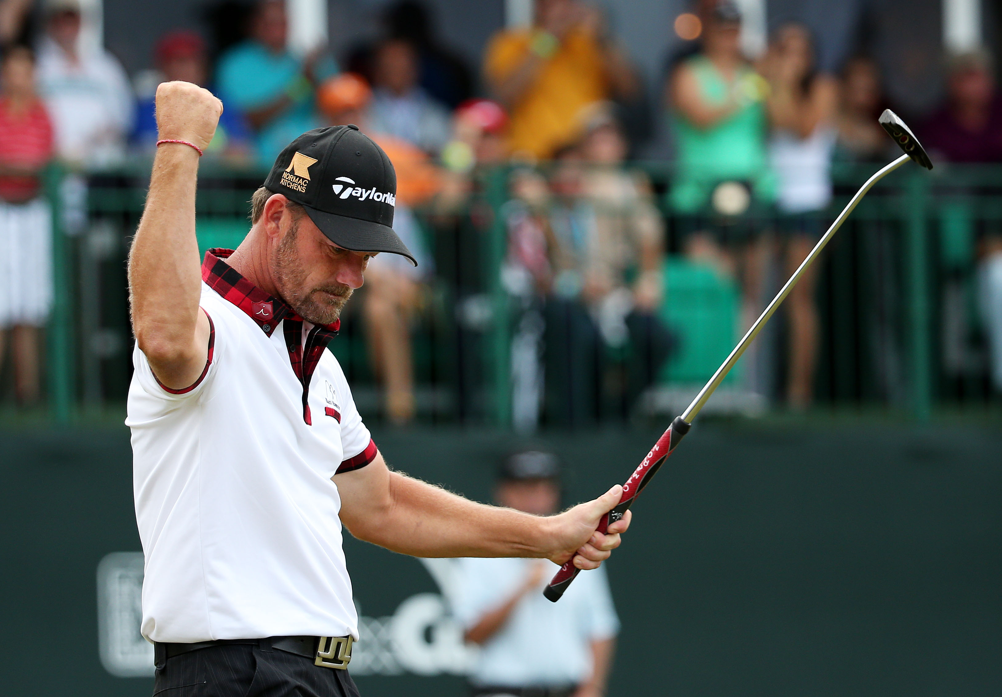 Alex Cejka celebrates on the 18th green following his playoff victory at the Puerto Rico Open.