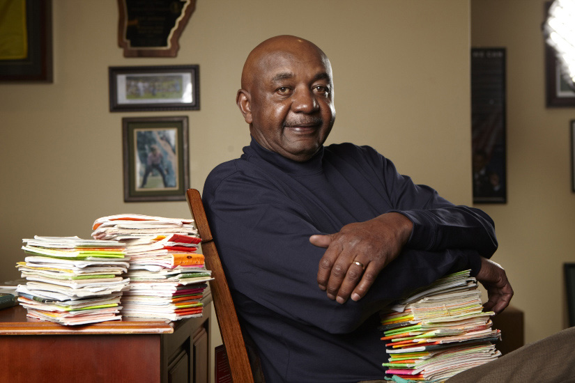 Carl Jackson at home with his yardage books.