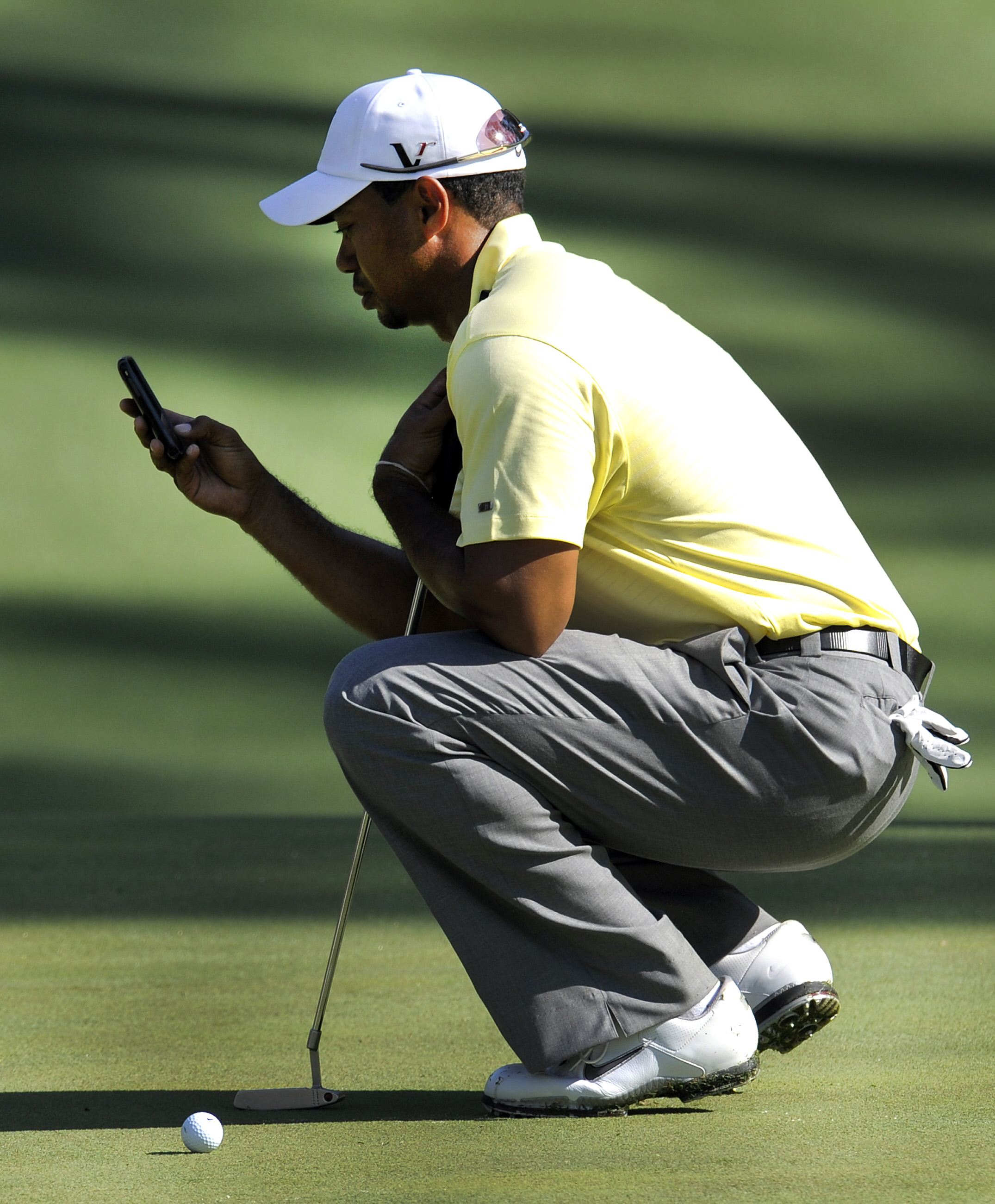 """""""Hey, Butchy ... yeah, it's Tiger. No, no one's around. Now about that chipping tip..."""""""
