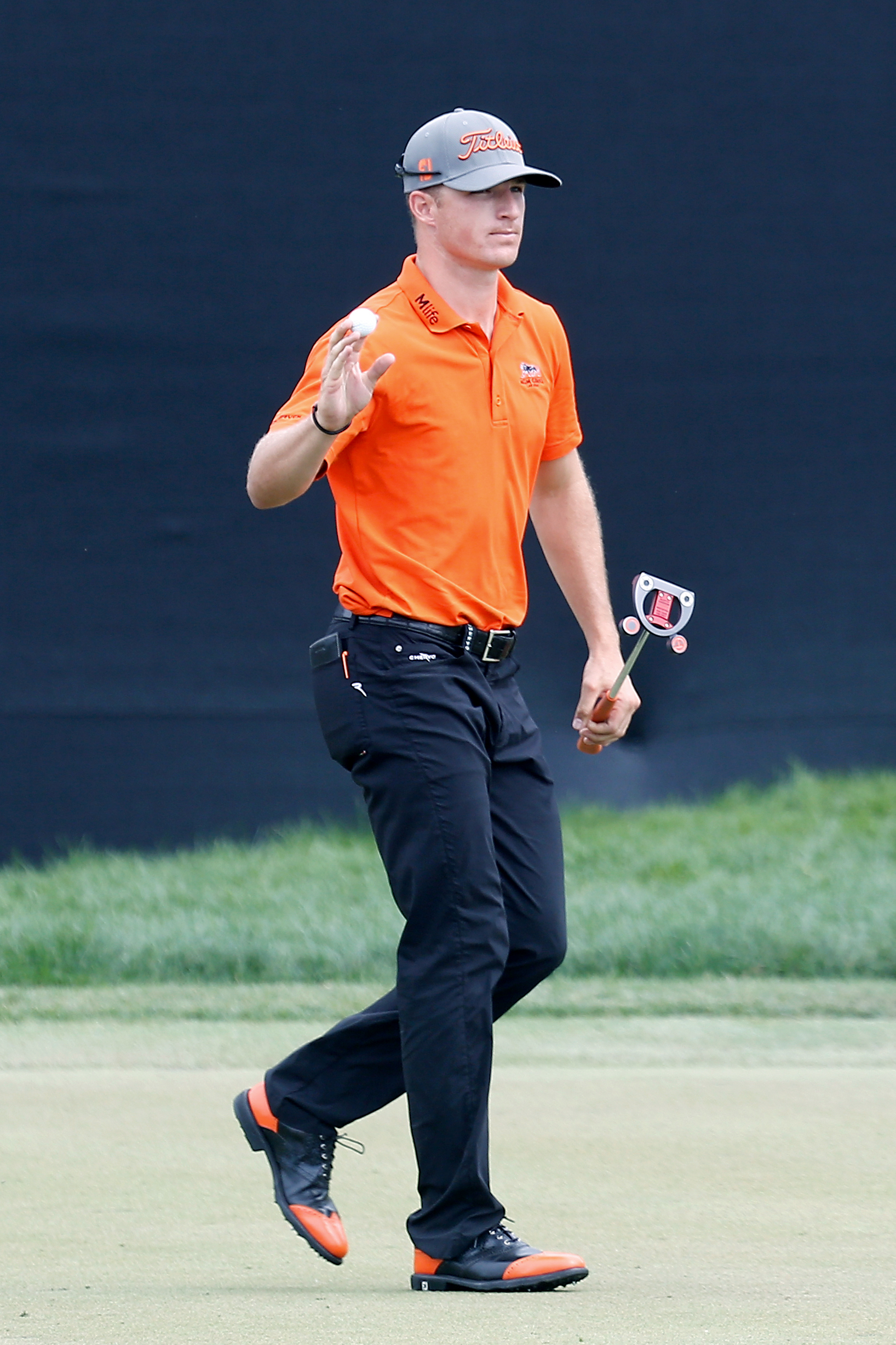 Morgan Hoffmann acknowledges the crowd after making a putt on the eighth green during the final round of the Arnold Palmer Invitational golf tournament in Orlando, Fla., Sunday, March 22, 2015. (AP Photo/Reinhold