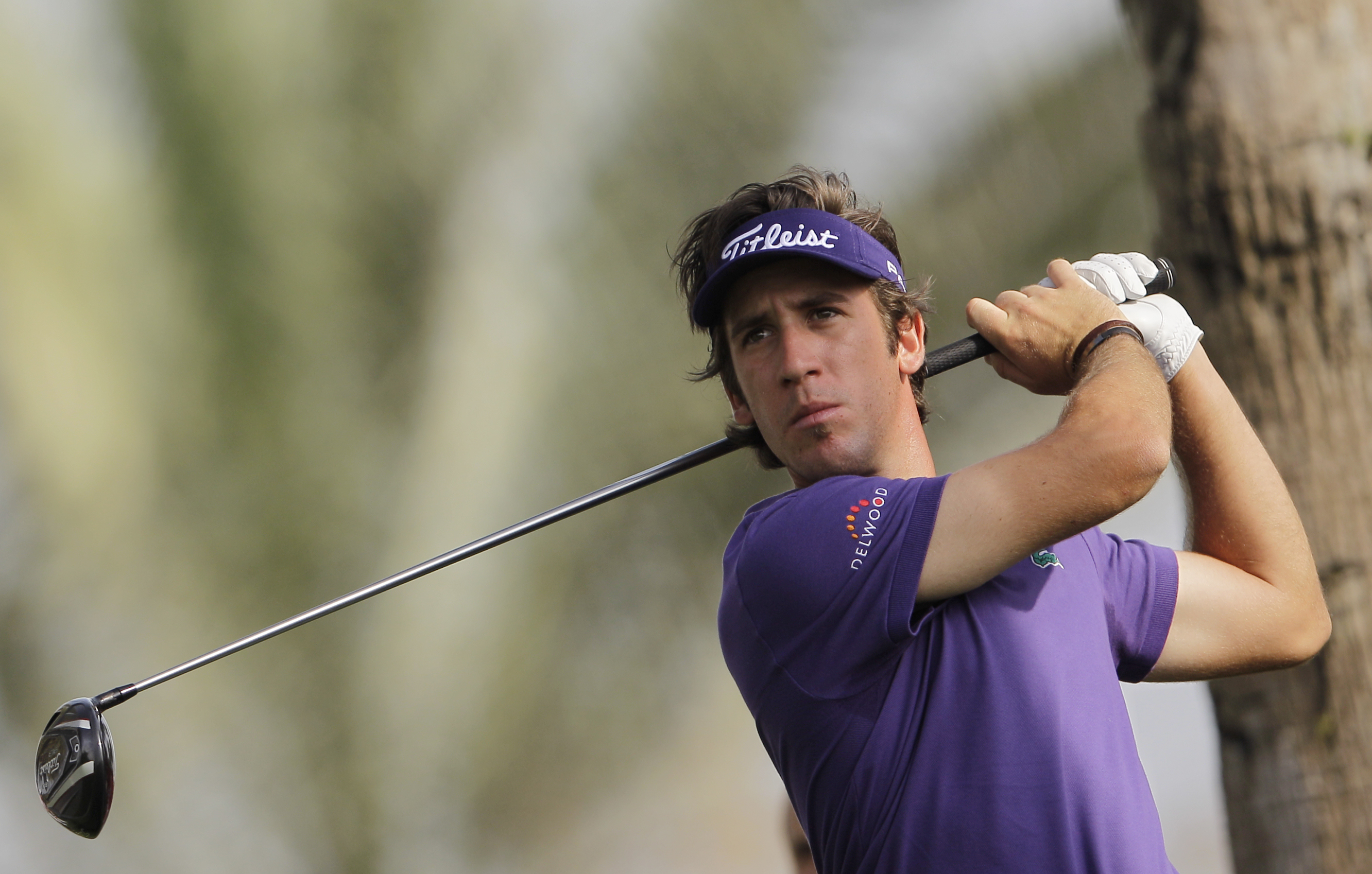 Romain Wattel of France plays a ball on the 8th hole during the second round of the Dubai Desert Classic Golf tournament in Dubai, United Arab Emirates, Friday, Feb. 1, 2013. (AP Photo/Kamran