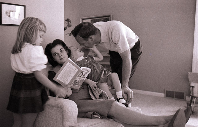 Arnold (at home in Latrobe with Winnie and daughters Peggy and Amy in 1960) always had a way with kids.