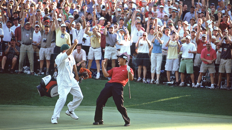 Tiger Woods celebrates on the 17th green during the final round of the 2005 Masters Tournament.