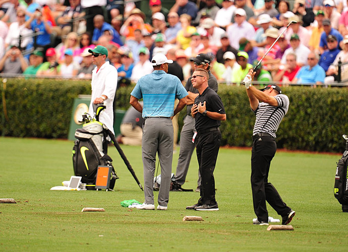 Foley appeared to consult with Tiger about his swing briefly.