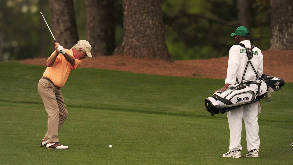 Ben Crenshaw takes a swing during a practice round Monday at Augusta National Golf Club.