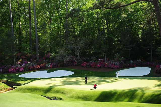 Tiger Woods lines up a putt on the 13th green at the 2009 Masters.