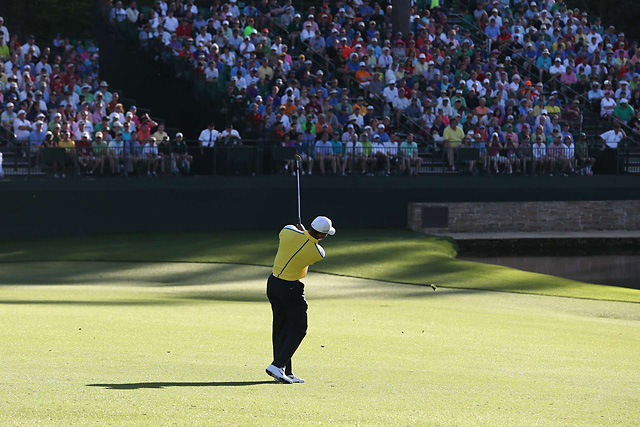 Tiger Woods hits his approach shot to the 15th hole in the second round of the 2013 Masters.