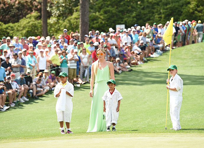 Lindsey Vonn watched over the kids as they followed Tiger around the Par-3 course.
