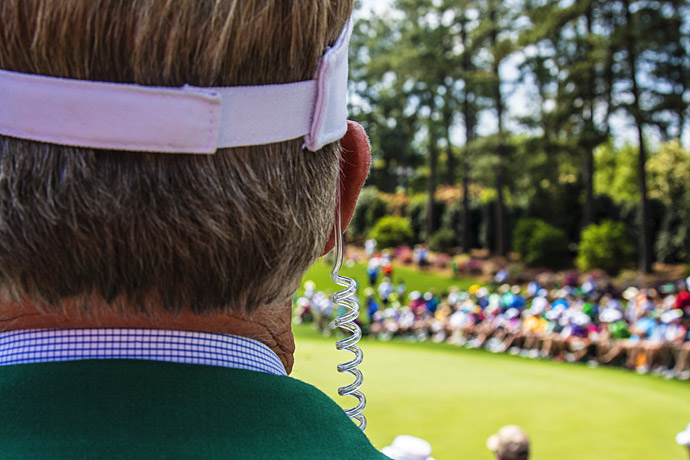 A Masters tournament official watches the action on Wednesday.