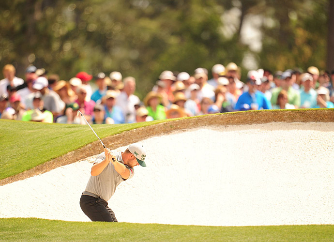 Ryan Moore hits out of a bunker during the first round.