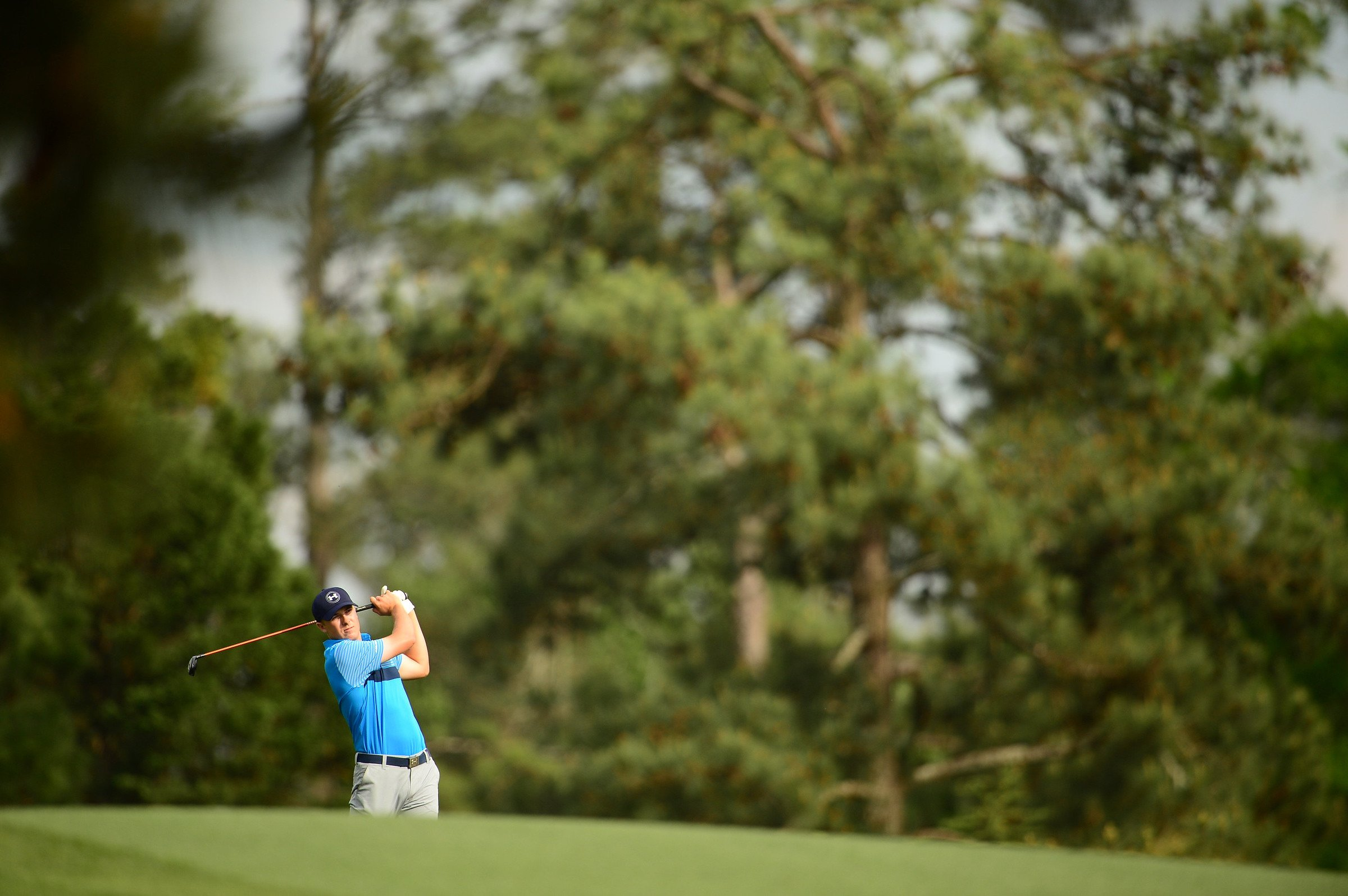Jordan Spieth plays his second shot on the 15th hole at Augusta National during the 2015 Masters.