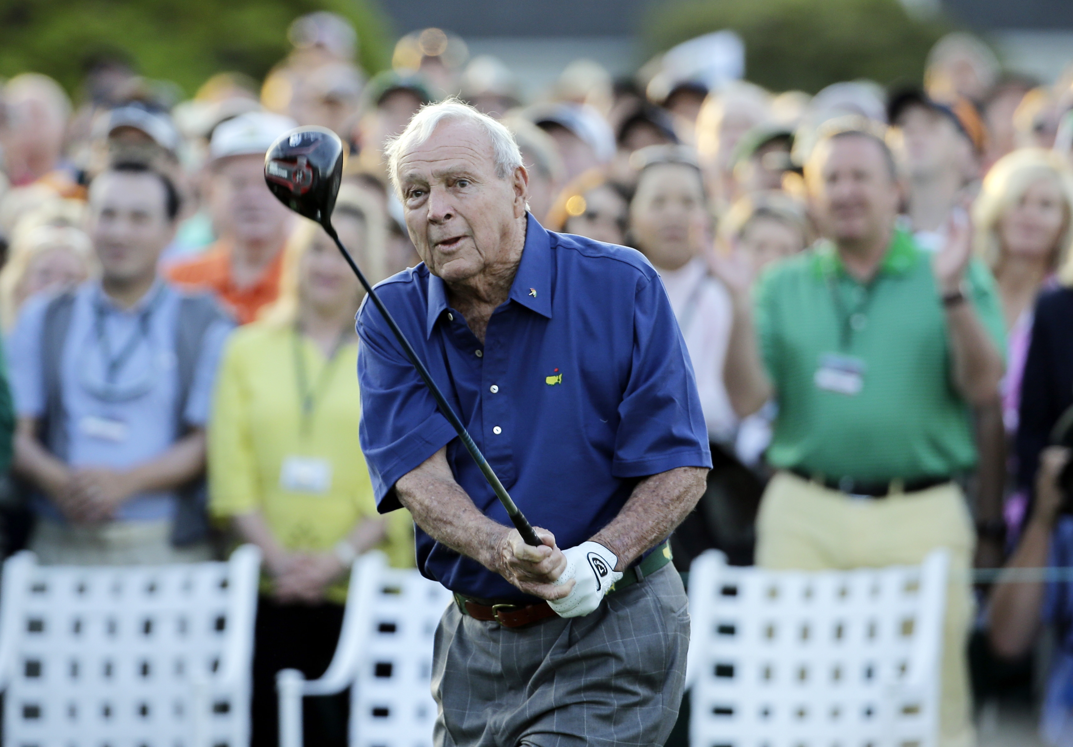 Arnold Palmer watches his tee shot for the honorary tee off before the first round of the 2015 Masters.