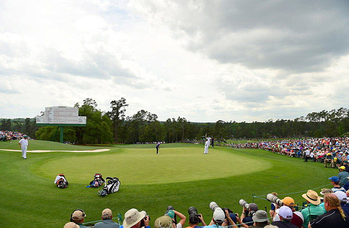 Spieth finishes up his second round on the 18th green.
