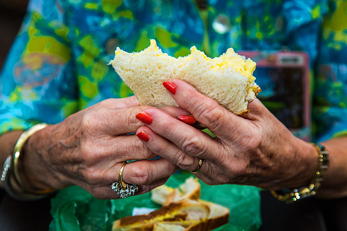 A spectator enjoying one of Augusta National's famous pimento cheese sandwiches.