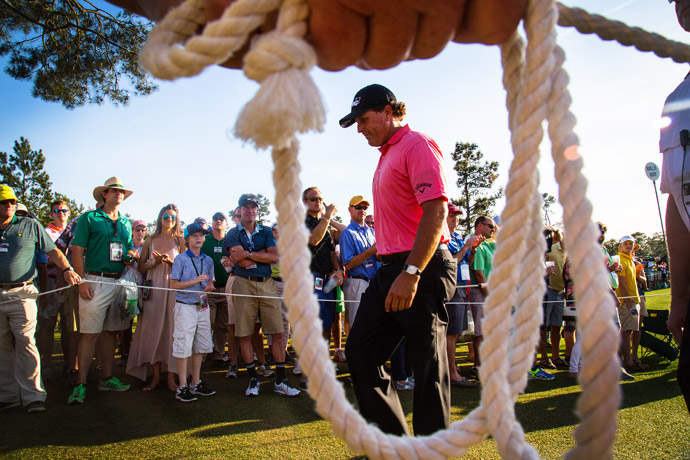Phil Mickelson passes by patrons during Saturday's third round.