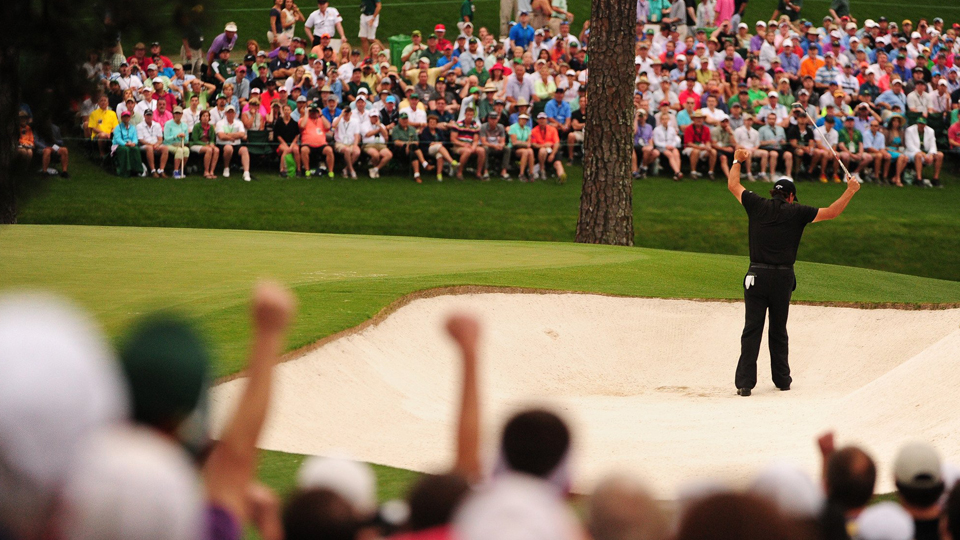 Phil Mickelson celebrates after holing out for eagle from the bunker on the 15th hole.