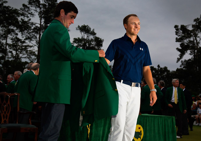Last year's champion Bubba Watson puts the green jacket on Jordan Spieth.
