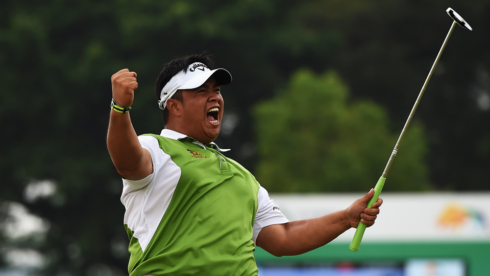 Kiradech Aphibarnrat of Thailand celebrates his winning putt during his playoff against Li Hao-Tong after the final round of the Shenzhen International at Genzon Golf Club on April 19, 2015, in Shenzhen, China.