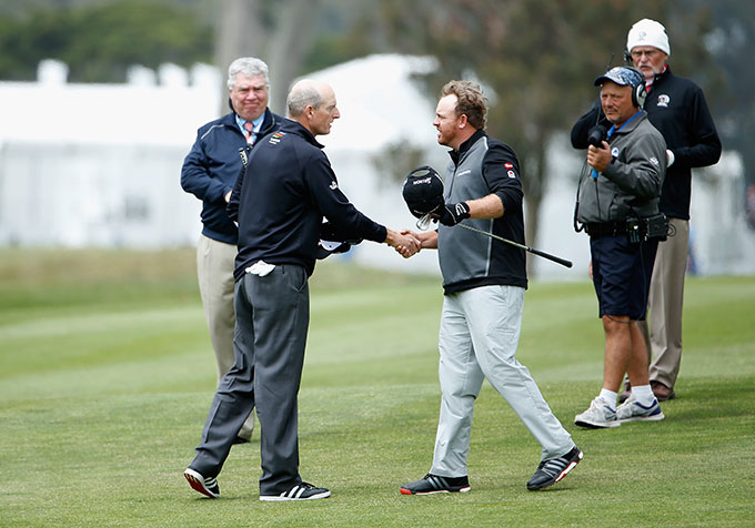 Jim Furyk and J.B. Holmes shake hands after Furyk won 5&3.