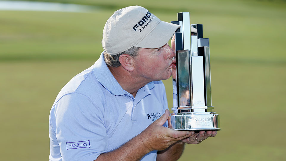 Ian Woosnam kisses the trophy at the Insperity Invitational.