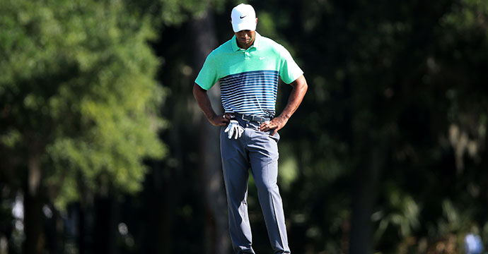 Tiger Woods reacts on the second hole during round three of THE PLAYERS Championship.