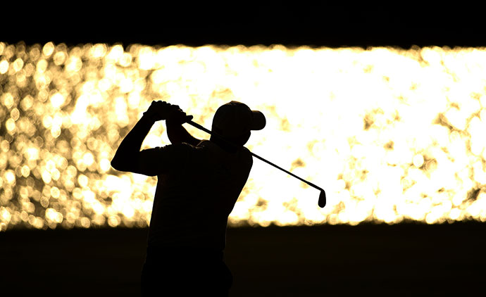 Bill Haas plays his second shot on the 18th hole during round three of THE PLAYERS Championship.