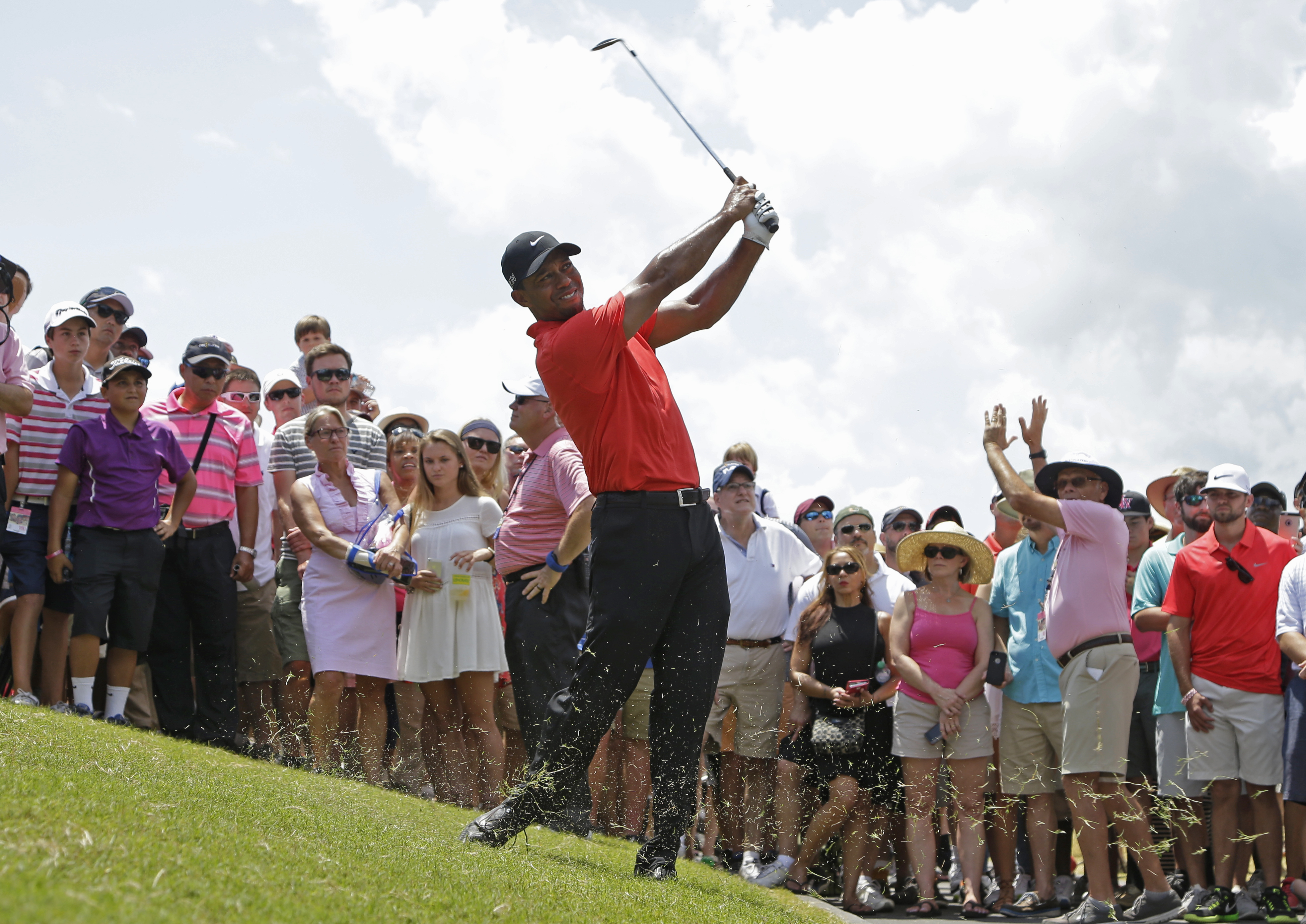 Tiger Woods hits from the rough off the 18th fairway during the final round of the Players Championship on Sunday in Ponte Vedra Beach, Florida.