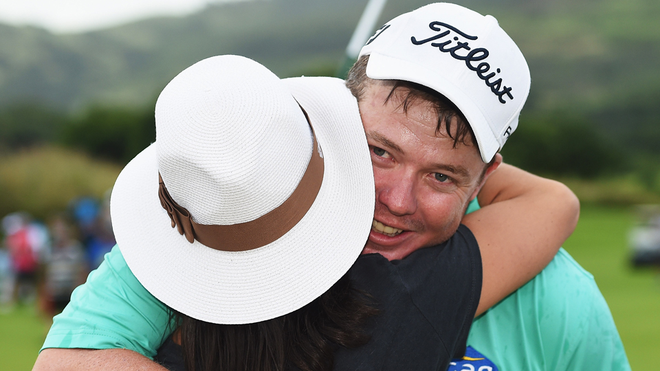 George Coetzee of South Africa celebrates on the 18th hole during the final round of the AfrAsia Bank Mauritius Open at Heritage Golf Club Sunday in Bel Ombre, Mauritius.