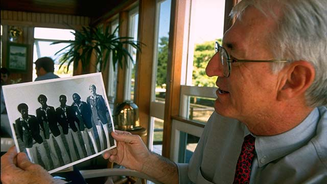 Former secretary-treasurer of the FGA Tony Cooper looking at photo of Vijay Singh (second from right) and the 1980 Fiji Amateur Team.