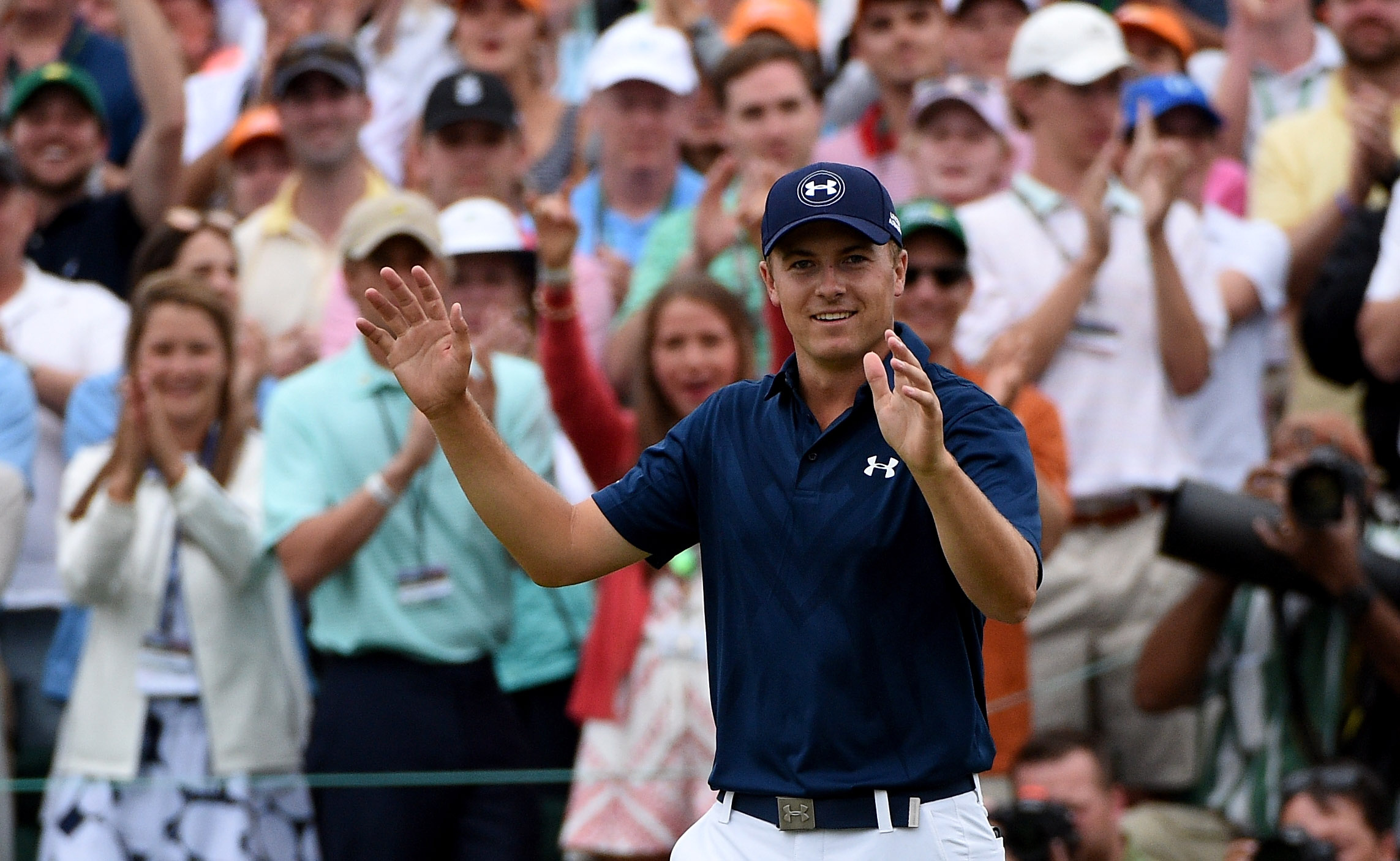Jordan Spieth acknowledges the crowd at Augusta National after winning the 2015 Masters.