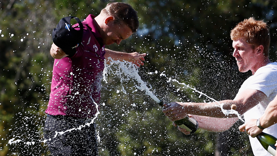 James Morrison (left) of England is sprayed with champange by friends after winning the Spanish Open held at Real Club de Golf el Prat on May 17, 2015, in Barcelona, Spain.