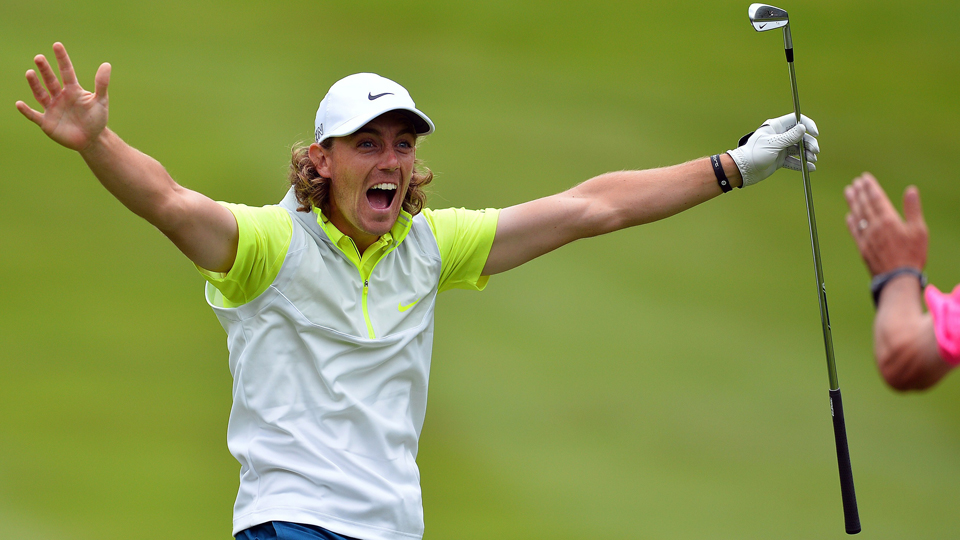 Tommy Fleetwood celebrates holing his second shot for an albatross on the fourth hole during the BMW PGA Championship at Wentworth on May 23, 2015.