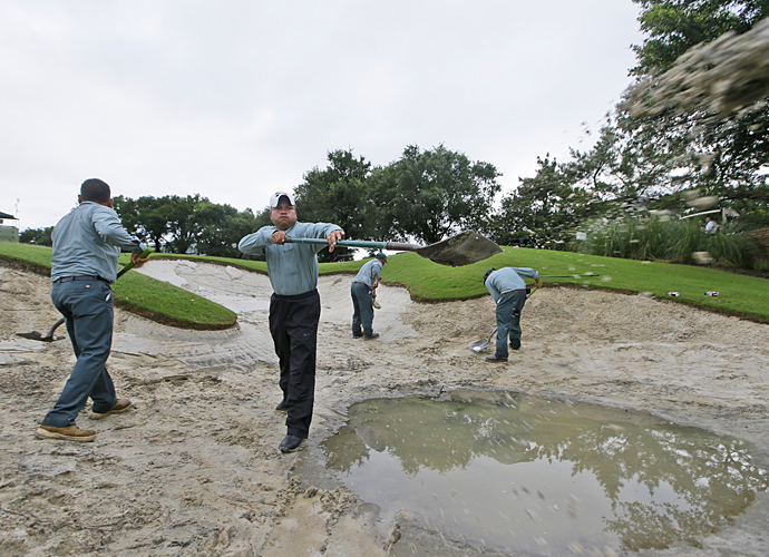 Members of the maintenance staff worked diligently to get the course dry enough for golf.