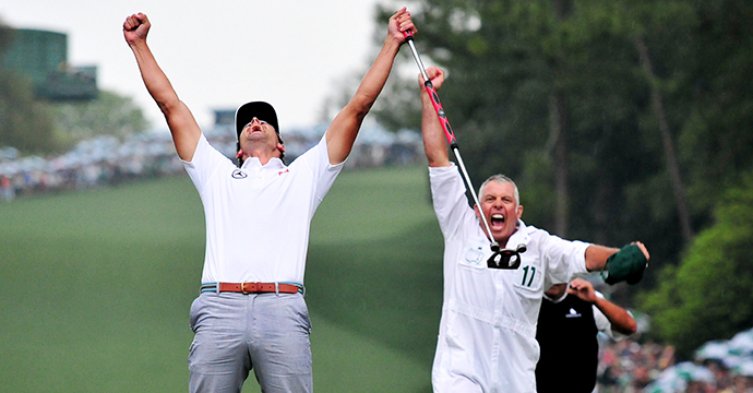 Adam Scott, left, celebrates with his caddie Steve Williams on the No. 10 green after winning the 2013 Masters Tournament.