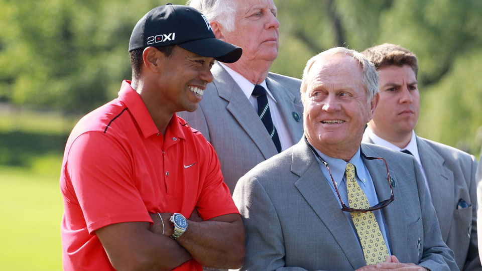 Tiger Woods and Jack Nicklaus share a laugh at the trophy ceremony during the 2012 Memorial Tournament.