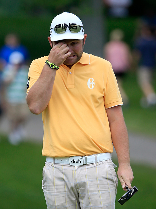 Andy Sullivan of England reacts to a missed birdie putt on the eighth hole during Day 3 of The Memorial Tournament.