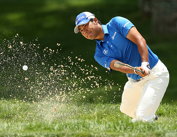 Defending champ Hideki Matsuyama of Japan hits his second shot on the 4th hole during the third round of The Memorial Tournament.