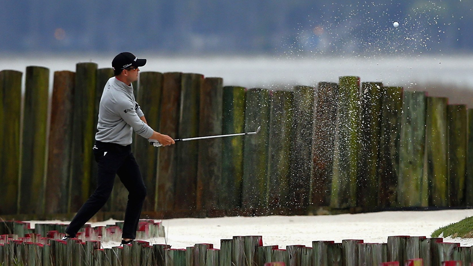 Zach Johnson found the bunker on the 17th hole during the first round of the RBC Heritage on April 16, 2015.