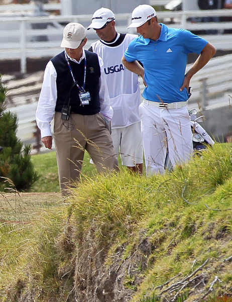 Dustin Johnson, his caddie Bobby Brown and a USGA rules official look into a hazard on the 4th hole during the final round of the 110th U.S. Open at Pebble Beach in 2010. Johnson held a three-shot leading entering the final round, but he shot a final-round 82 and tied for eighth.