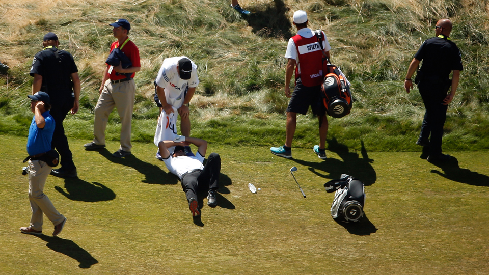 Jason Day is overcome by dizziness and lays on the ninth hole during the second round of the U.S. Open.