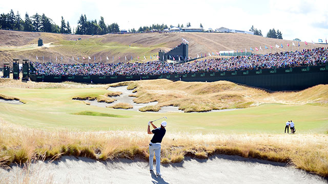 Jordan Spieth hits from a bunker on the 18th hole today at the U.S. Open.