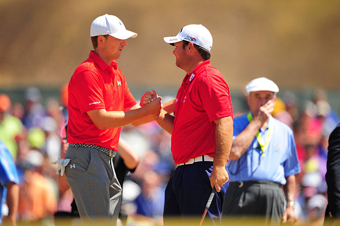 36-hole co-leaders Jordan Spieth and Patrick Reed shake hands before starting the third round.