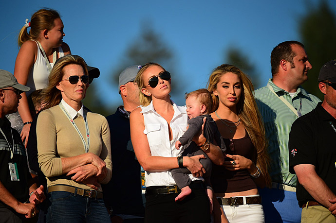 Johnson's fiancee Paulina Gretzky and young son Tatum watched the final round.